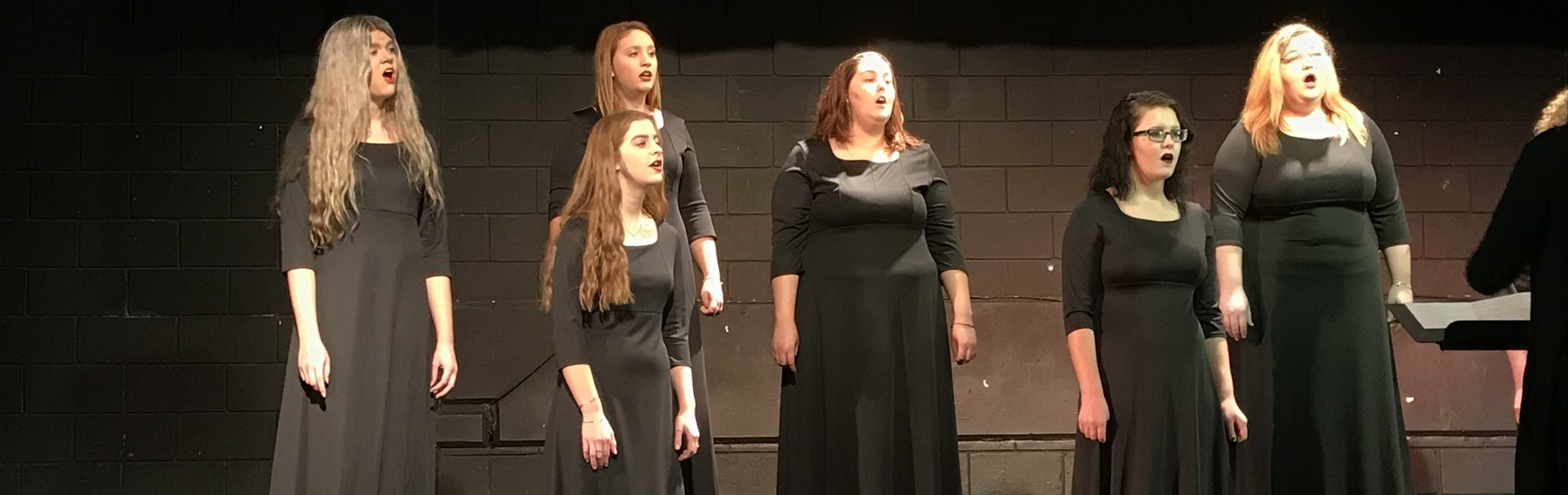Chorus students singing on stage