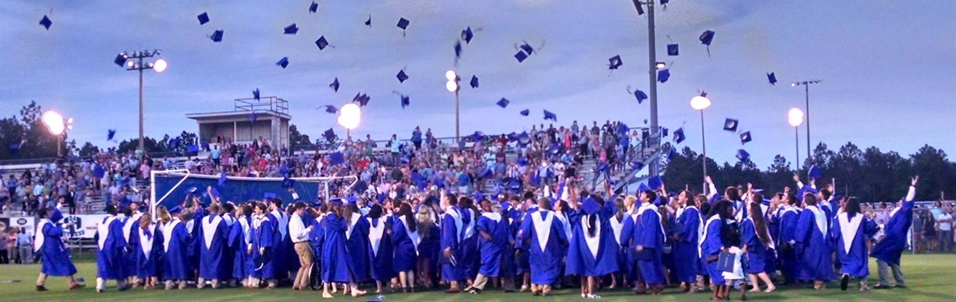 PCHS graduates throwing caps in the air