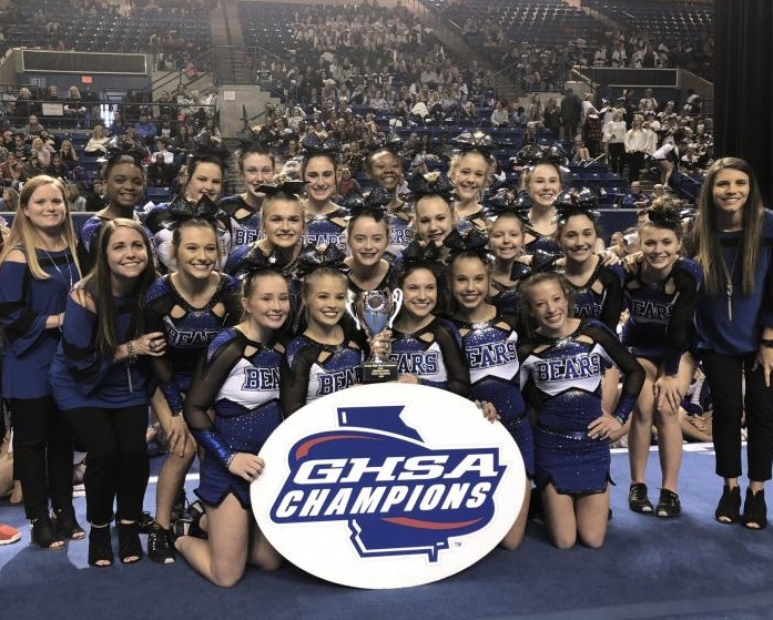 PCHS Competition Cheerleaders holding trophy
